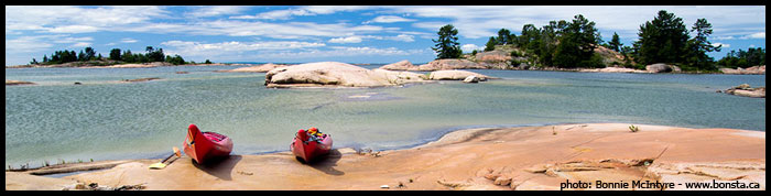 Kayaks on the pink granite shorelines of Phillip Edward Island Killarney Ontario ,Bonnie McIntyre www.bonsta.ca 1 226 228 3755