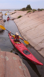 Sneaking 		             through Phillip Edward Island, kayak, Killarney Ontario