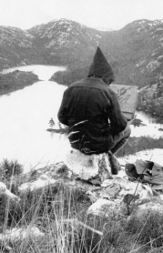 Franklin Charmichael sketching on his rock, Grace Lake 1935